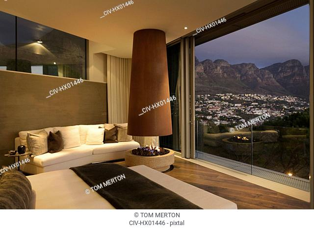 Modern luxury fireplace and home showcase bedroom with mountain and city view