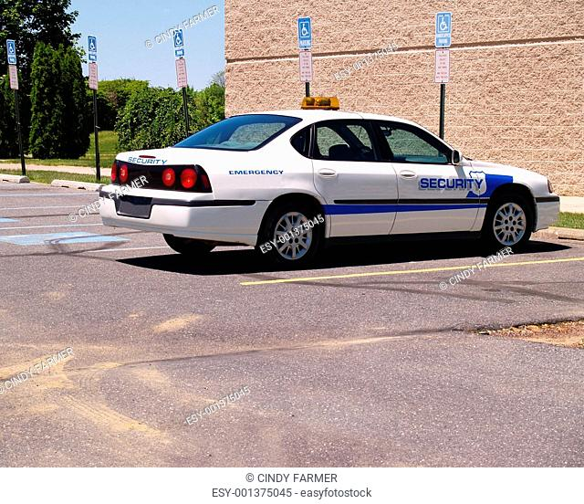 empty security vehicle in a parking lot