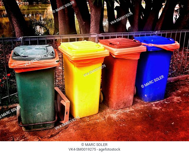 Colorful plastic containers in a row for separate garbage collection. Barcelona, Catalonia, Spain
