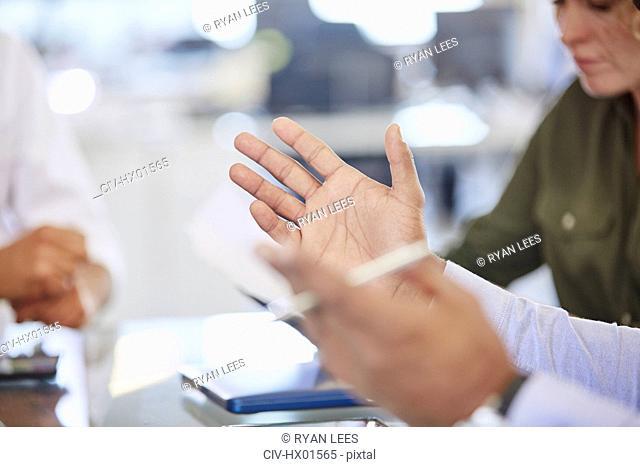 Hands of businessman gesturing in meeting