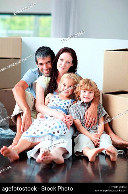 Famiy lying on floor after buying house