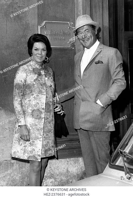 British actor Rex Harrison and Rachel Roberts visit the tailor Valentino, Rome, Italy, 1960s. Welsh actress Rachel Roberts (1927-1980) became Rex Harrison's...