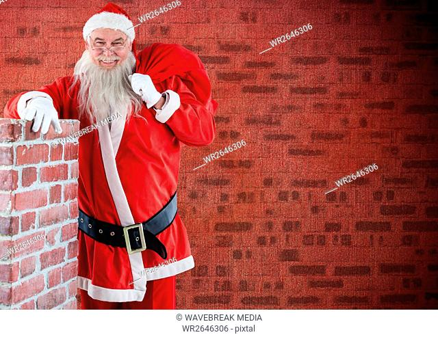 Santa claus with gift sack standing beside a chimney