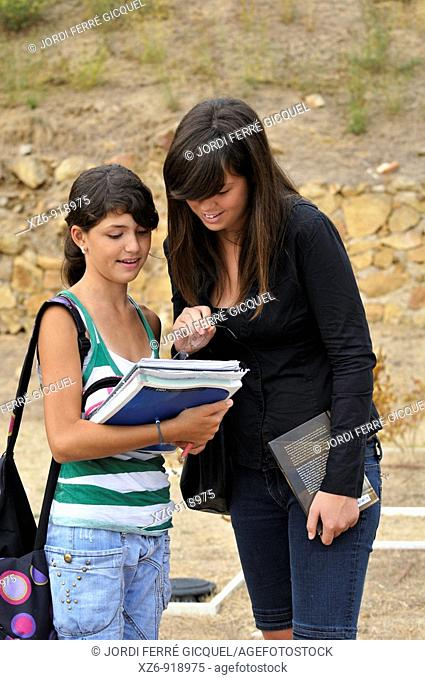 student taking a lesson outside Roman ruins