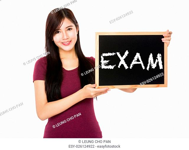 Asian woman hold with the blank chalkboard showing a word exam