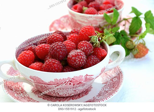 raspberries in a antique bowl with leaves