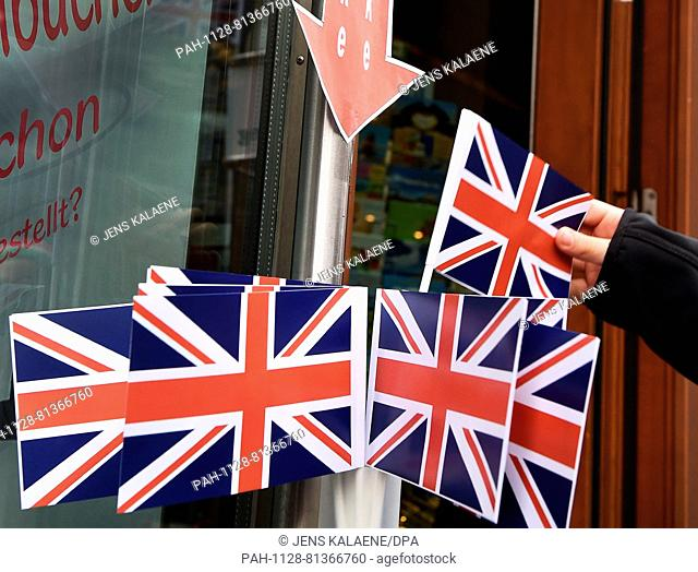 FILE - A file picture dated 24 June 2016 shows British flags for waving on sale in Berlin,Germany. Queen Elizabeth II and her husband were on a visit to...