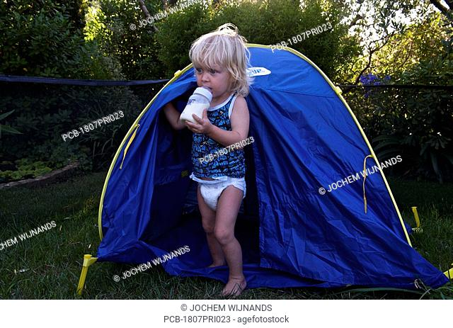 Toddler crawling out of tent
