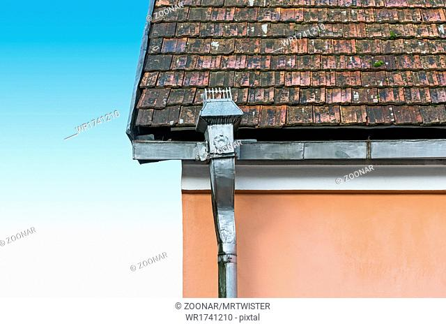 Old tile roof and rain gutter