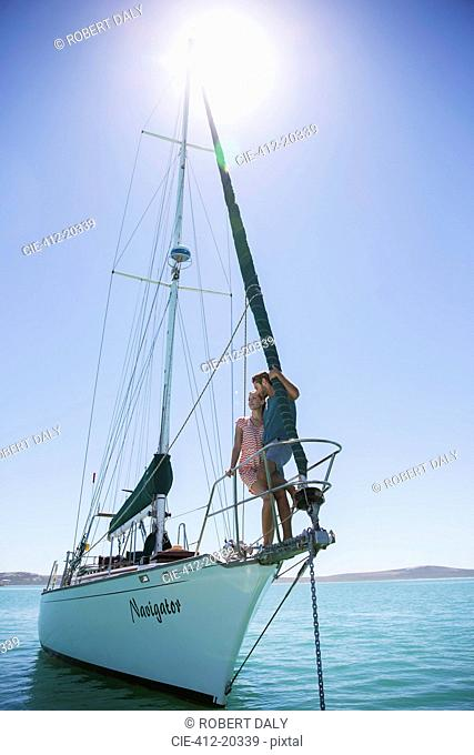 Couple standing on end of boat
