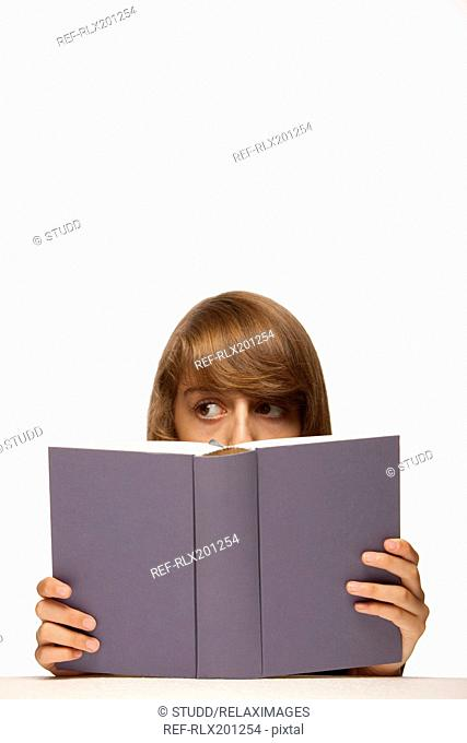 Girl book reading hiding concentrating learning