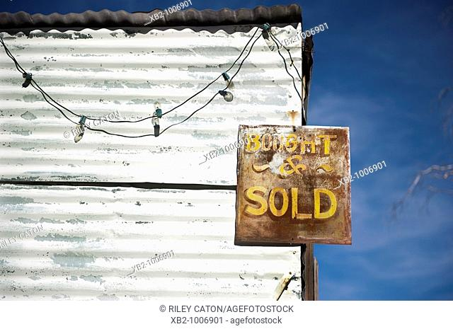 Route 66, Arizona - An antique sign on an abandon building along the road