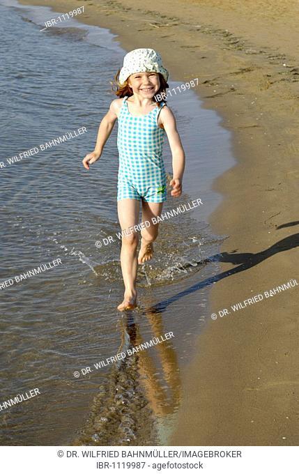 Child running on the beach, seaside of the Adria, Bibione, Venetia, Venice, Italy, Europe