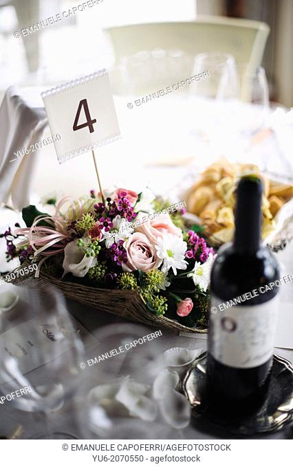 Restaurant table with wine bottle and floral decoration