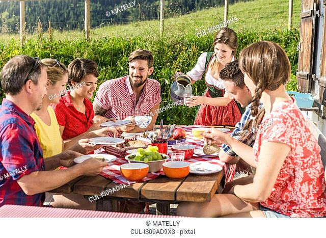 Group of friends enjoying breakfast, Tyrol, Austria