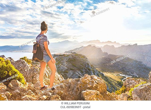 Woman enjoying view from hilltop, Mallorca, Spain
