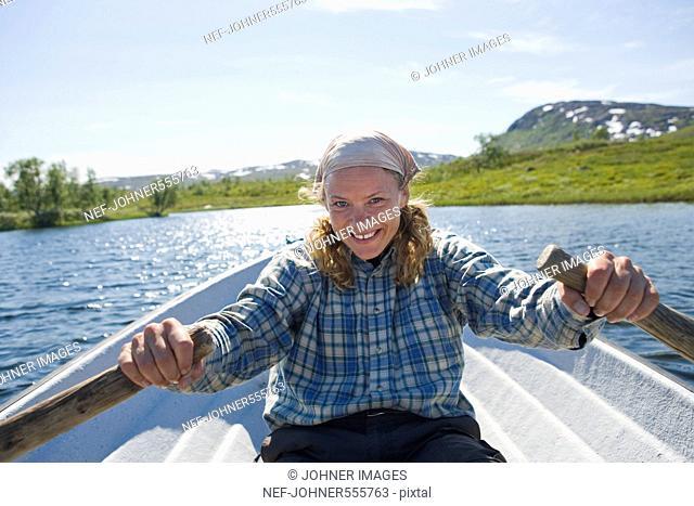A woman rowing a boat, Hemavan, Sweden