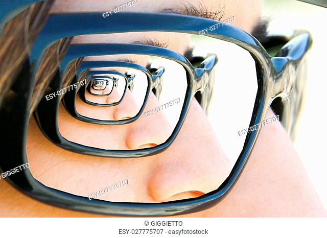 Mirror sunglasses Droste. Look of a girl with sunglasses with droste effect