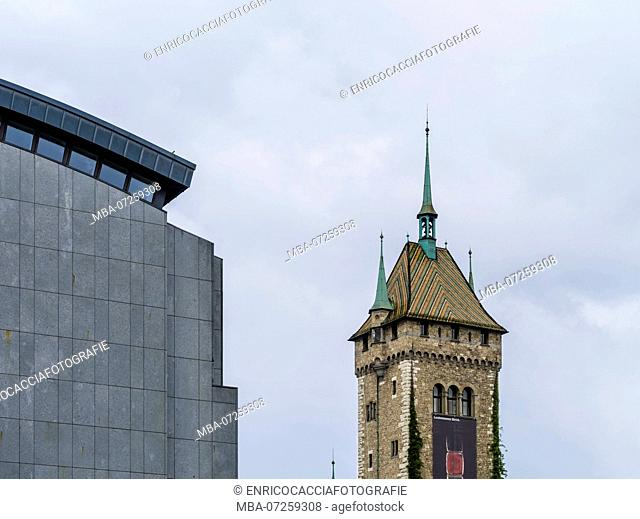 Tower of the State Museum and modern extension of the main station in Zurich