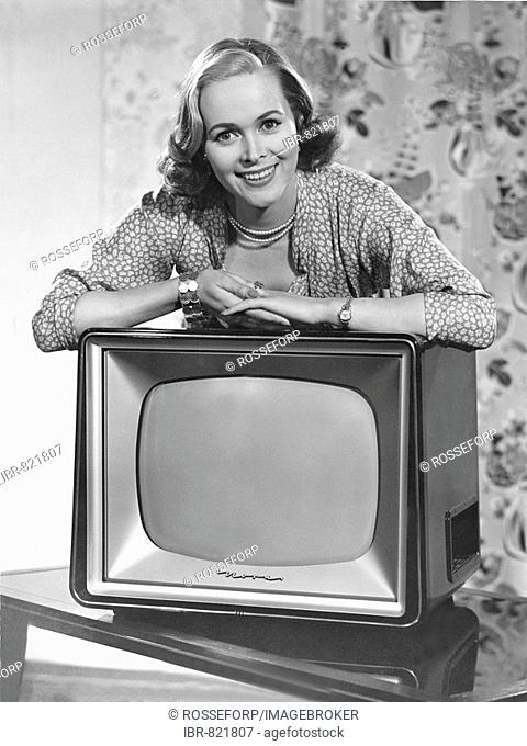 Woman posing with a television, historical photo, circa 1955
