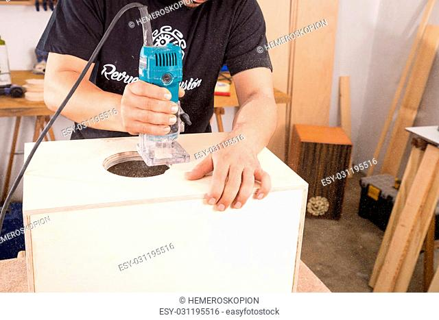 Milling machine being used to craft a cajon flamenco percussion instrument