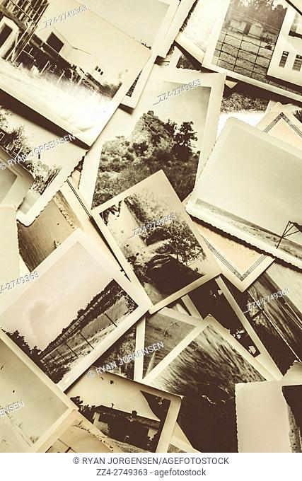 Press photographers photo album in a scattered display of old black and white memorabilia. Snapshot of history