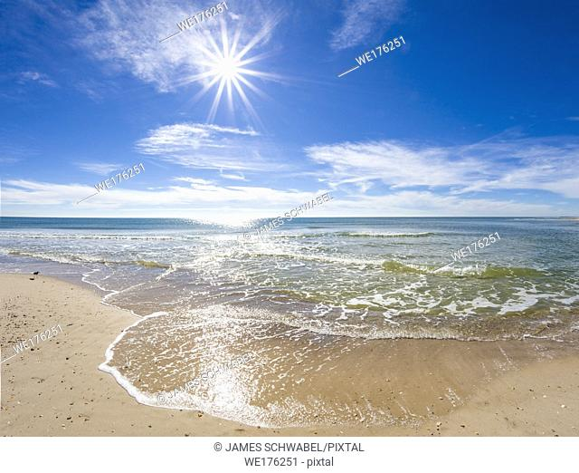 Sunburst on sunny day over the Gulf of Mexico on St George Island in the panhandle or forgotten coast area of Florida in the United States