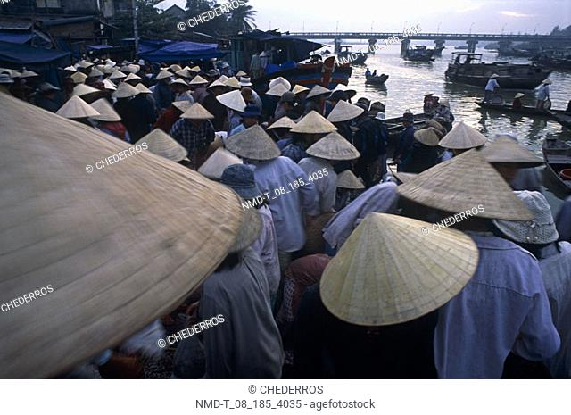 Group of people standing on the riverbank, Vietnam