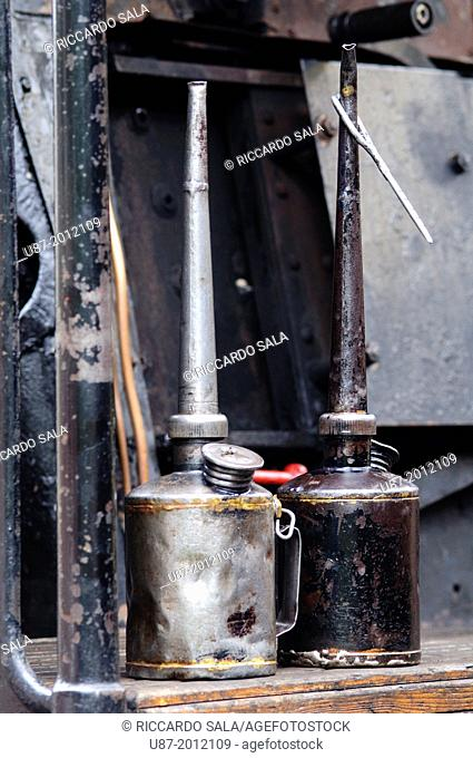 Italy, Lombardy, Two Old Oil Cans in a Historical Steam Train
