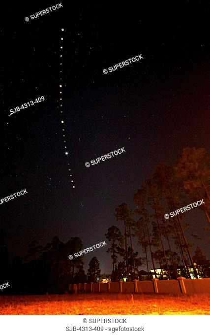 A multiple-exposure sequence captures the total lunar eclipse of December 21, 2010, near Daytona Beach, Florida