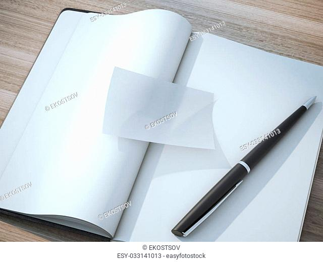Transparent business card on the blank moleskin