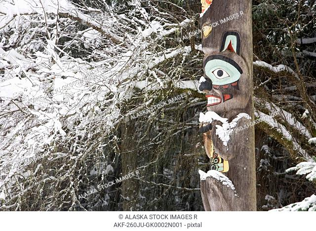 Brown bear totemic figure on Tlingit totem pole at Auke Bay recreation area
