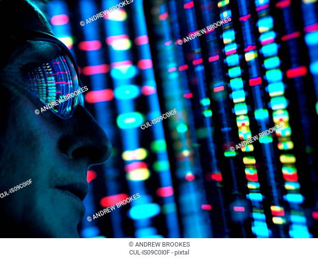 Genetic Research, scientist viewing DNA information on screens, close up