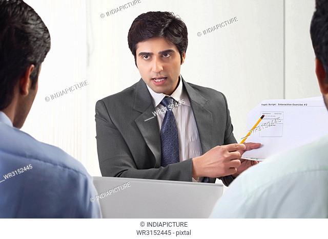 Three businessmen in meeting
