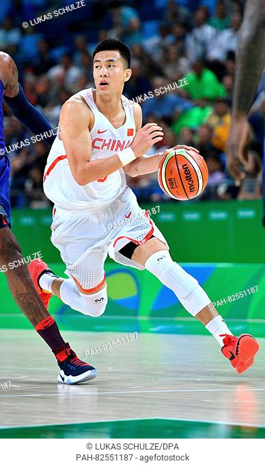 Zhao Jiwei of China plays the ball during the Basketball Preliminary Round Group A match of the Rio 2016 Olympic Games at the Carioca Arena 1, Rio de Janeiro