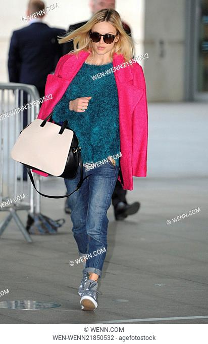 Fearne Cotton arriving at the BBC Radio 1 studios wearing a fuchsia coat, green woolen sweater and adidas trainers Featuring: Fearne Cotton Where: London