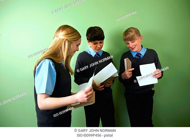 Three friends opening exam results