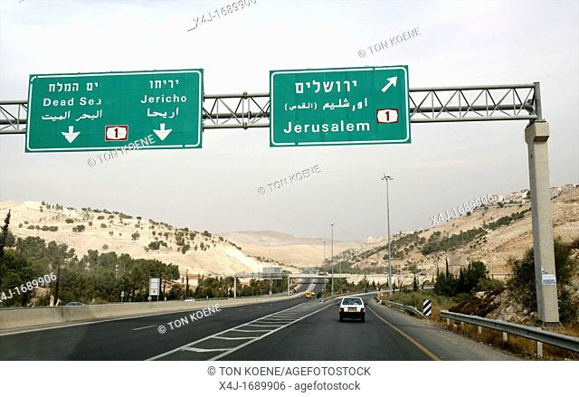 Road signs near the wall Israel is building around the west bank territories, blocking access for Palestinians who feel imprisoned by it