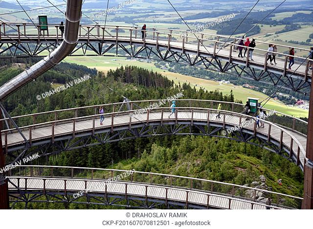 Tourists enjoy Sky Walk, a wooden structure 55 metres above the ground, beyond the tree tops. Standing some 1116 metres above sea level