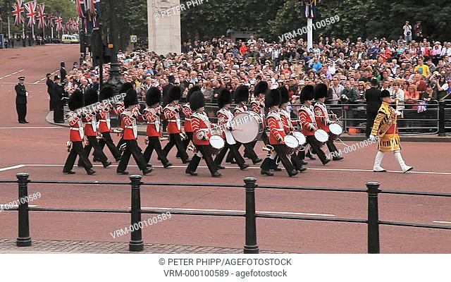 Grenadier Guards Band Marches near to Buckingham Place in the Mall at London