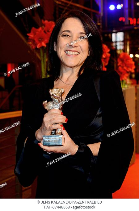 Chilean actress Paulina Garcia, winner of the Silver Bear for Best Actress for her film 'Gloria', poses with the trophy after the awards ceremony at the 63rd...
