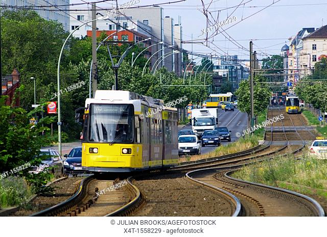 Modern trams on the streets of the former East Berlin with busy traffic