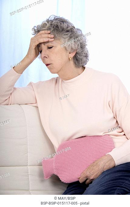 Senior woman with a hot water bottle