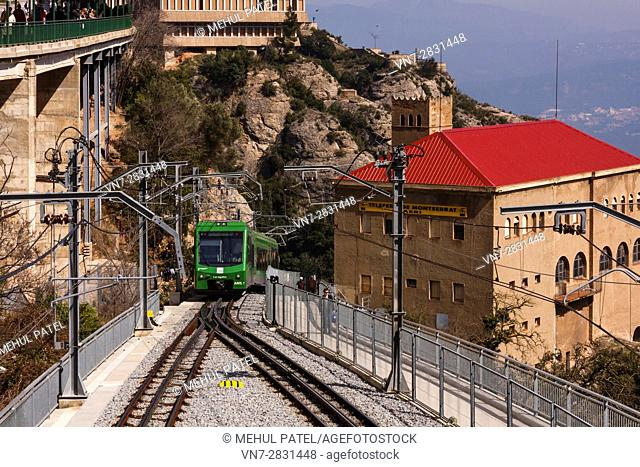 Rack railway train climbing up Montserrat mountain, Catalonia, Spain. The Montserrat rack railway train is the quickest way to climb the Montserrat mountain and...