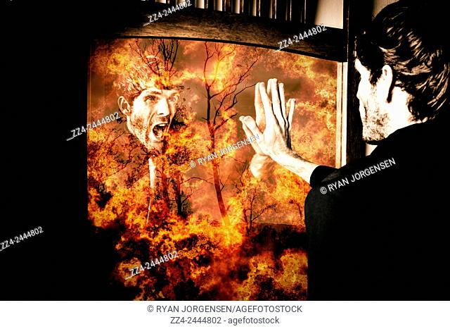 Man facing a mirrored reflection of fiery inner turmoil when selling his soul and the well-being of all, for power and greed