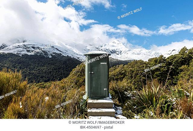 Outhouse, view of mountains with snow, Fiordland National Park, Southland Region, New Zealand