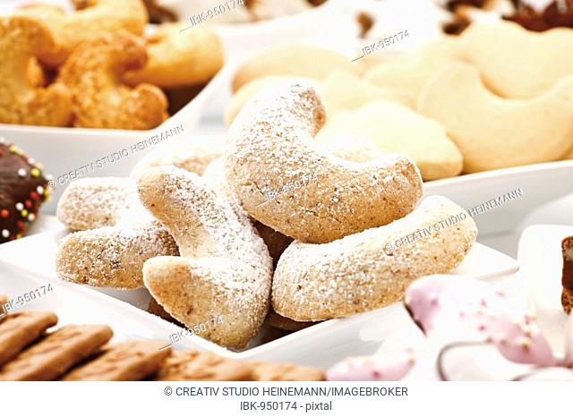 Vanillekipferl or Almond Crescents or Sand Tarts covered in caster sugar