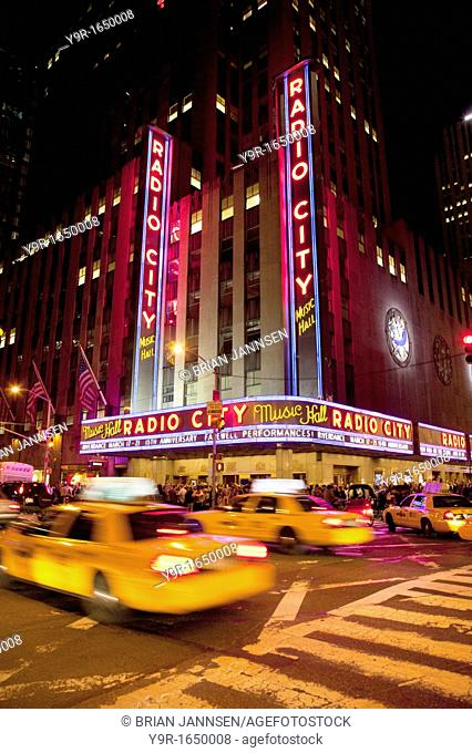 Taxis drive by Radio City Music Hall in Manhattan, New York City USA