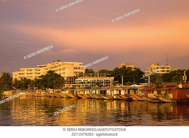 Dragon boat cuises at sunset on the river Huong (Perfume River). Vietnam. Dragon head and excursion boat, Song Huong or Huong Giang or Perfume River, near Hue