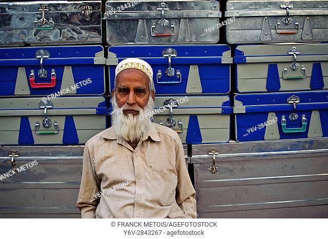Man selling metal cases at Champa ( Chhattisgarh state, India). He belongs to the Dawoodi Bohra community